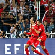 Turkey's Umut Bulut (L) with Sercan SARARER celebrates his goal during their FIFA World Cup 2014 qualifying soccer match Turkey betwen Estonia at Sukru Saracoglu stadium in Istanbul September 11, 2012. Photo by TURKPIX