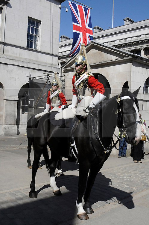 ©  licensed to London News Pictures. . UK.27/04/2011.Royal Wedding Preparations today in London with only two days to go before the big day..The Queens Life Guard preparing at Horse Guards Parade.Please see special instructions..Picture credit should read Grant Falvey/LNP......