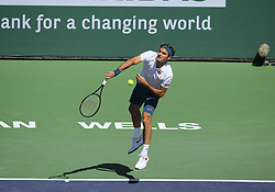 March 15, 2019 - Indian Wells, CA, U.S. - INDIAN WELLS, CA - MARCH 15: Roger Federer (SUI) hits a serve during the quarterfinals of the BNP Paribas Open on March 15, 2019, at the Indian Wells Tennis Gardens in Indian Wells, CA. (Photo by Adam Davis/Icon Sportswire) (Credit Image: © Adam Davis/Icon SMI via ZUMA Press)