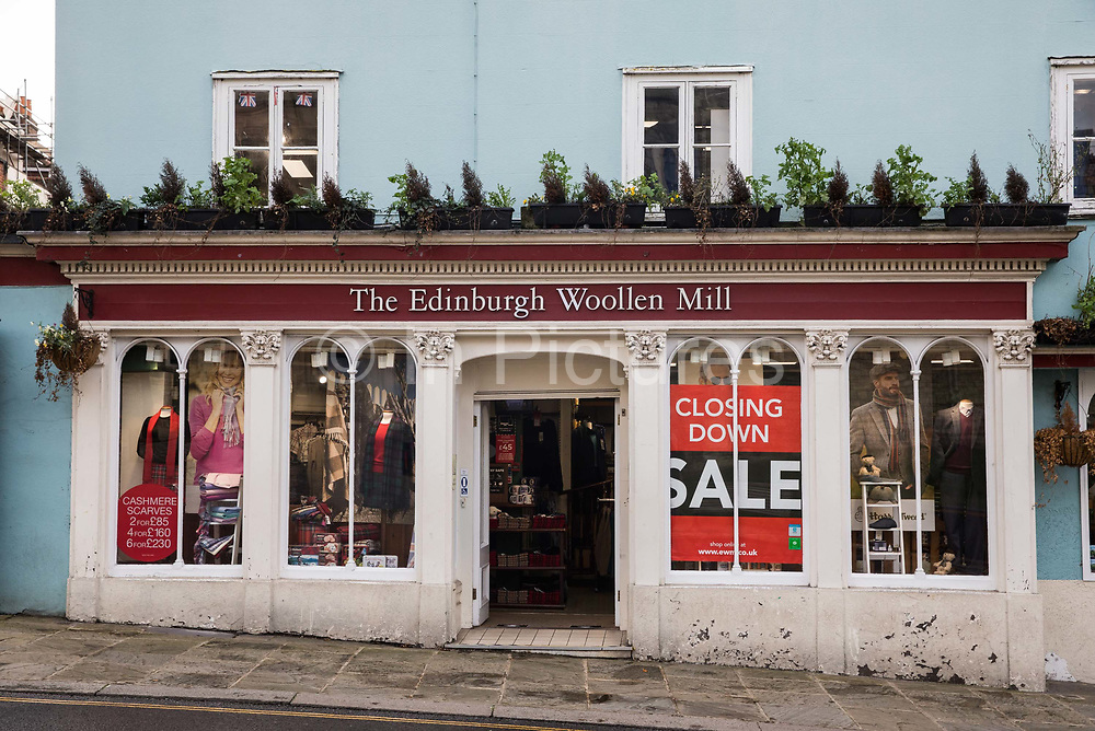 A Closing Down Sale sign is displayed in the window of a branch of The Edinburgh Woollen Mill on 3rd November 2020 in Windsor, United Kingdom. The struggling high-street fashion chain, which owns Peacocks and Jaeger, was given two weeks to find buyers or new investors as an alternative to going into administration on 23rd October.