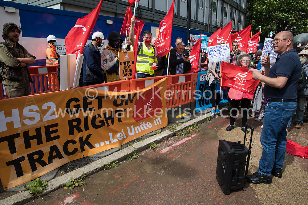 London, UK. 6th August, 2021. Steve Turner, candidate to become General Secretary of Unite, addresses Unite members protesting outside the Euston construction site for the HS2 high-speed rail link regarding trade union access to construction workers building tunnel sections for the project. Unite claims that HS2's joint venture contractor SCS, formed by Skanska, Costain and Strabag, has been hindering 'meaningful' trade union access to HS2 construction workers in contravention of the HS2 agreement.