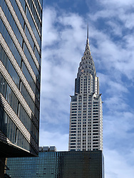 The Chrysler Building is an Art Deco–style skyscraper located in the Turtle Bay neighborhood on the East Side of Midtown Manhattan, New York City, at the intersection of 42nd Street and Lexington Avenue.