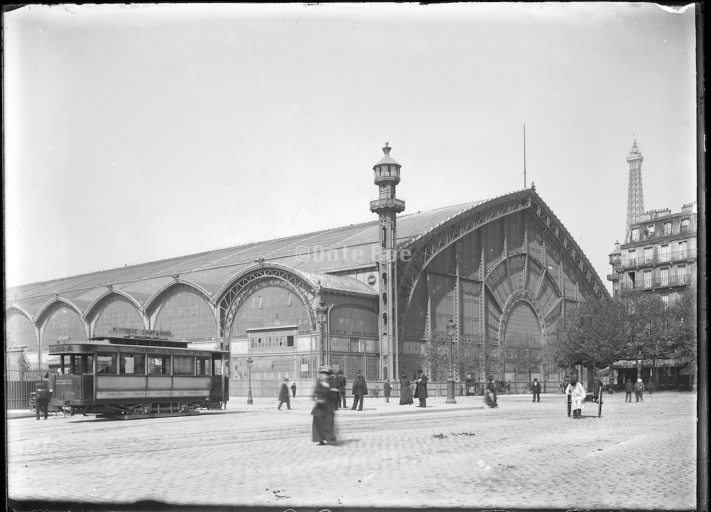 expo hall and top of the Eiffel tower after  Exposition Universelle de Paris 1900, around 1905