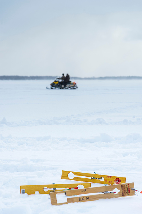 Participants in the Michigan DNR Becoming an Outdoors Woman program learn ice fishing on Lake Independence in Big Bay, Michigan.