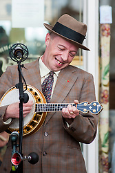 George Formby (AKA Paul Casper) plays in Northallerton Town Square after Robin went down on one knee to pop the question to Suzanne on Saturday Morning<br /> <br /> 15 June 2013<br /> Image © Paul David Drabble<br /> www.pauldaviddrabble.co.uk