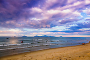 Sun sets while  looking at Cham Island from An Bang Beach in Hoi An, Vietnam. RAW to Jpg