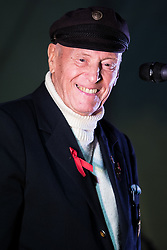 © Licensed to London News Pictures. FILE PICTURE 25/08/2014. GEORGE MONTAGUE, known as the Oldest Gay in the Village , speaking on stage at an AIDS memorial candlelit vigil at the close of Manchester Pride in 2014. George Montague, who was convicted in 1974 of gross indecency with a man, has received a formal apology from the Home Office for the British Government's historical homophobic criminalisation of gay people. The government announced gay and bisexual men convicted of now-abolished sexual offences would receive postumous pardons. Photo credit: Joel Goodman/LNP