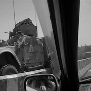 Seen from an Afghan civilians automobile, a heavily armed US armored vehicle rumbles down the main highway through Kandahar City, Afghanistan. Due to the violence armored vehicles have become a necessity for US military personel. However they also alienate Afghan civilians from soldiers and  dominate the roads in Kandahar City as every NATO convoy going west must travel through the city angering and frustrating Kandahari's. (Credit Image: © Louie Palu/ZUMA Press/The Alexia Foundation).....