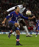 Photo: Paul Thomas/Sportsbeat Images.<br />England v Croatia. UEFA European Championships Qualifying. 21/11/2007.<br /><br />Josip Simunic (L) battles with Micah Richards of England.