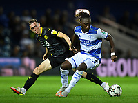 Football - 2021 / 2022 EFL Carabao Cup - Round Two - Queens Park Rangers vs Oxford United - Kyan Prince Foundation Stadium - Tuesday 24th August 2021.<br /> <br /> Osman Kakay of Queens Park Rangers holds off the challenge from Gavin White of Oxford United.<br /> <br /> COLORSPORT/Ashley Western