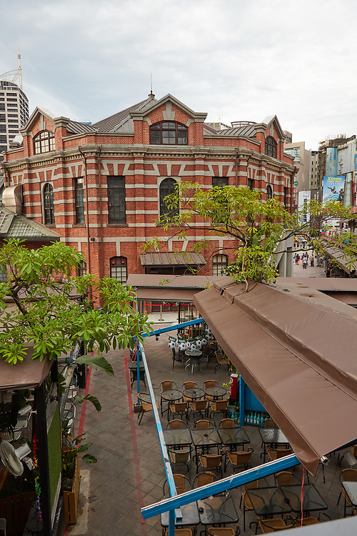 The historic Red House Theatre in Ximending. Originally built in 1908, the building was renovated in the early 2000's following a fire. It currently hosts regular concerts and performances by student groups and professional musicians.The area next to the building is a popular part of Taipei's LGBT scene, with shops and bars catering to the diversity of the city.