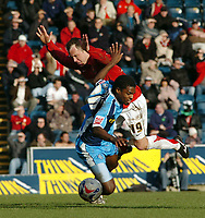 Photo: Kevin Poolman.<br />Wycombe Wanderers v Walsall. Coca Cola League 2. 17/03/2007. Anthony Grant of Wycombe is taken out by Kevin Cooper of Walsall.