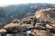 Leif Anderson runs along the summit ridge of Little El Capitan in Popo Agie Wilderness, Wind River Range, Wyoming.
