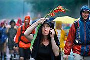 Nederland, Nijmegen, 20-7-2007Vierdaagse, Tijdens de intocht brak rond half twee op de St Annastraat, via gladiola,een stortbui met onweer uit. Ondanks het slechte weer blijven de lopers doorgaan, met de finish in zicht.Foto: Flip Franssen/Hollandse Hoogte