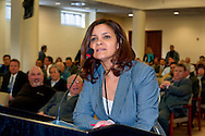 Nassau County Legislature, controlled by Republicans, votes along party lines to consolidate 8 police precincts into 4, on Monday, March 5, 2012, at Mineola, New York, USA. Milagros Vicente (at podium) a North Valley Stream resident, spoke against closing precincts.