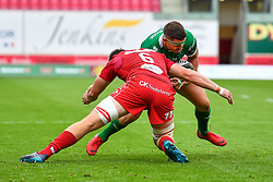 Luca Morisi of Benetton Treviso is tackled by Ed Kennedy of Scarlets<br /> <br /> Photographer Craig Thomas/Replay Images<br /> <br /> Guinness PRO14 Round 3 - Scarlets v Benetton Treviso - Saturday 15th September 2018 - Parc Y Scarlets - Llanelli<br /> <br /> World Copyright © Replay Images . All rights reserved. info@replayimages.co.uk - http://replayimages.co.uk