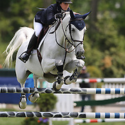 Sydney Shulman riding Quidam 13 in action during the $35,000 Grand Prix of North Salem presented by Karina Brez Jewelry during the Old Salem Farm Spring Horse Show, North Salem, New York, USA. 15th May 2015. Photo Tim Clayton