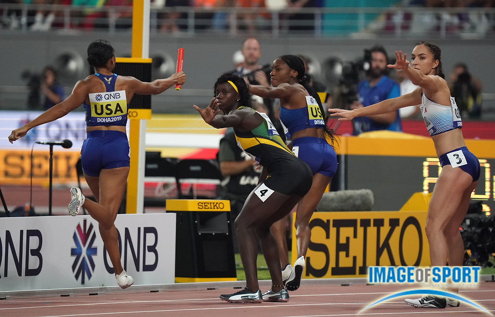 Sep 29, 2019; Doha; Qatar; Courtney Okolo prepares to ake the handoff from Allyson Felix on the third leg of the Untied States mixed 4 x 400m relay that won in a world record 3:09.34 during the IAAF World Athletics Championships at Khalifa International Stadium.