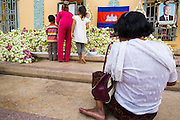 """30 JANUARY 2013 - PHNOM PENH, CAMBODIA: Cambodians pray at a memorial for former King Norodom Sihanouk at the Royal Palace in Phnom Penh. Sihanouk (31 October 1922- 15 October 2012) was the King of Cambodia from 1941 to 1955 and again from 1993 to 2004. He was the effective ruler of Cambodia from 1953 to 1970. After his second abdication in 2004, he was given the honorific of """"The King-Father of Cambodia."""" Sihanouk held so many positions since 1941 that the Guinness Book of World Records identifies him as the politician who has served the world's greatest variety of political offices. These included two terms as king, two as sovereign prince, one as president, two as prime minister, as well as numerous positions as leader of various governments-in-exile. He served as puppet head of state for the Khmer Rouge government in 1975-1976. Most of these positions were only honorific, including the last position as constitutional king of Cambodia. Sihanouk's actual period of effective rule over Cambodia was from 9 November 1953, when Cambodia gained its independence from France, until 18 March 1970, when General Lon Nol and the National Assembly deposed him. Upon his final abdication, the Cambodian throne council appointed Norodom Sihamoni, one of Sihanouk's sons, as the new king. Sihanouk died in Beijing, China, where he was receiving medical care, on Oct. 15, 2012. His cremation is scheduled to take place on Feb. 4, 2013. Over a million people are expected to attend the service.        PHOTO BY JACK KURTZ"""
