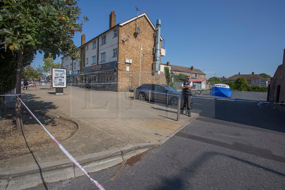 """©️ Licensed to London News Pictures. 14/09/2020. Dagenham, UK. Police remain at the crime scene in Dagenham, eastLondon. Police were called to a car park in Whalebone Lane South at 23:43hrs on Sunday, 13 September, to reports of a collision between a car and a pedestrian. Officers attended along with paramedics from London Ambulance Service. A 47-year-old man was found seriously injured and died at the scene a short time later. Enquiries to locate his next of kin are ongoing. A post-mortem examination will be carried out in due course. At this early stage, homicide detectives from the Met's Specialist Crime Command believe the man was hit by a car, which left the scene. Detective Chief Inspector Mark Wrigley said: """"We believe the victim was deliberately harmed and we are treating this incident as a murder inquiry. Photo credit: Marcin Nowak/LNP"""