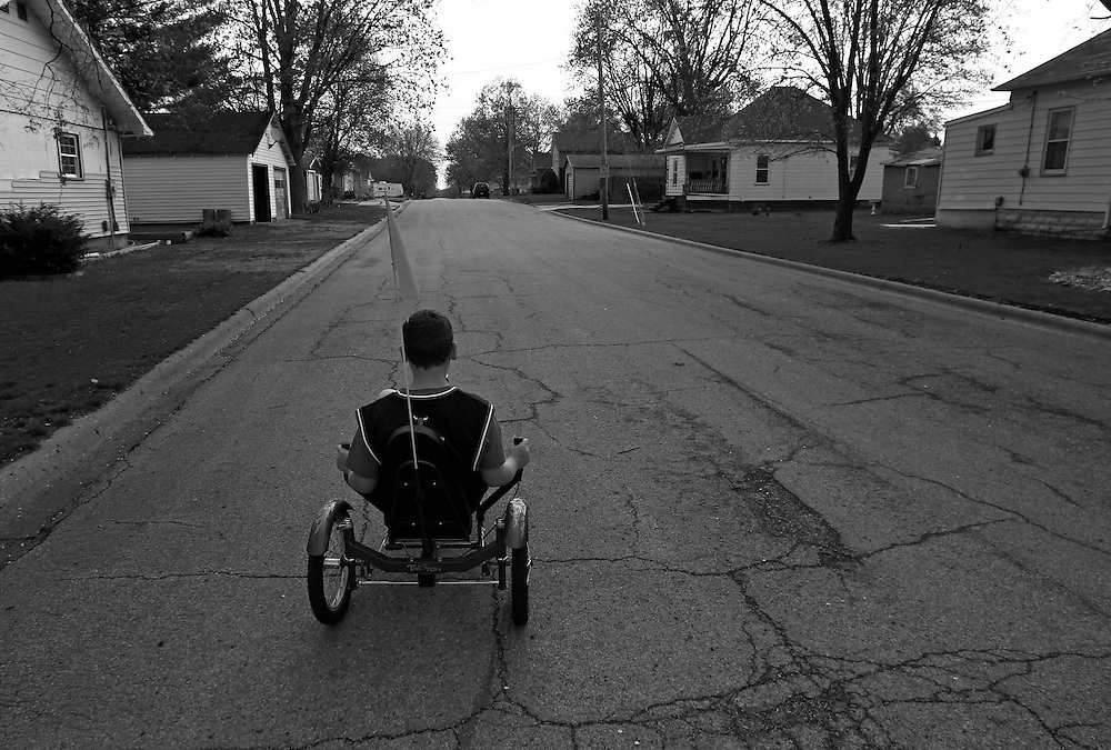 Parker Roos, who suffers from Fragile X,  rides his bike near his home in Canton, Illinois, April 4, 2012.  REUTERS/Jim Young