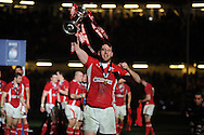 Welsh try scorer Alex Cuthbert celebrates as he holds the trophy. RBS Six nations championship 2013, Wales v England at the Millennium stadium in Cardiff , South Wales on Saturday 16th March 2013. pic by Andrew Orchard, Andrew Orchard sports photography,