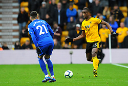 Willy Boly of Wolverhampton Wanderers tries to get past Victor Camarasa of Cardiff City- Mandatory by-line: Nizaam Jones/JMP - 02/03/2019 - FOOTBALL - Molineux - Wolverhampton, England -  Wolverhampton Wanderers v Cardiff City - Premier League