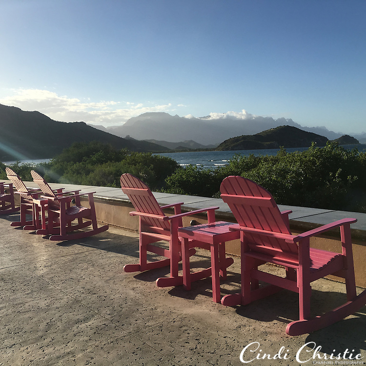 Hot pink rocking chairs are placed near the beach at  Villa del Palmar at the Islands of Loreto on Saturday, Oct. 24, 2015, in Loreto, Mexico.  (© 2015 Cindi Christie/Cyanpixel)