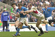 Twickenham, Surrey, 9th March2003, Six nations International Rugby,  RFU Stadium, England, [Mandatory Credit; Peter Spurrier/Intersport Images]<br /> Photo Peter Spurrier<br /> 09/03/2003<br /> RBS Six Nations Rugby England v Italy<br /> Italian centre Giovanni Raineri is tackled by Lawrence Dallaglio as Dan Luger moves in to assist