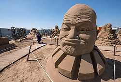 "© Licensed to London News Pictures. 12/05/2019. Weston-super-Mare, North Somerset, UK. The Weston-super-Mare Sand Sculpture Festival at Weston's beach. A sand sculpture titled ""What if we were controlled by Aliens?"" by artist Jan Zelinka. The Weston Sand Sculpture Festival promises a new theme each year and this year the broad ""What If…?"" topic has allowed artists to create conceptual pieces of art portraying some important and alarming messages from Brexit, Climate Change to Feminism. Photo credit: Simon Chapman/LNP"