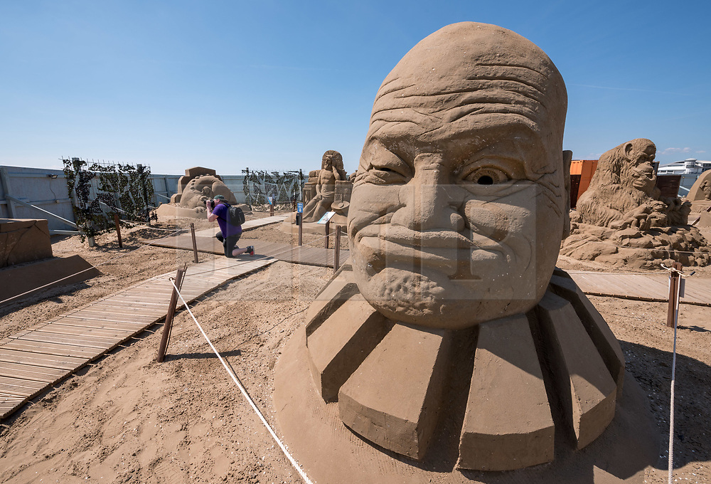 """© Licensed to London News Pictures. 12/05/2019. Weston-super-Mare, North Somerset, UK. The Weston-super-Mare Sand Sculpture Festival at Weston's beach. A sand sculpture titled """"What if we were controlled by Aliens?"""" by artist Jan Zelinka. The Weston Sand Sculpture Festival promises a new theme each year and this year the broad """"What If…?"""" topic has allowed artists to create conceptual pieces of art portraying some important and alarming messages from Brexit, Climate Change to Feminism. Photo credit: Simon Chapman/LNP"""