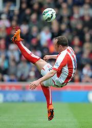 Stoke City's Charlie Adam attempts an overhead kick  - Photo mandatory by-line: Dougie Allward/JMP - Mobile: 07966 386802 - 09/05/2015 - SPORT - Football - Stoke - Britannia Stadium<br />  - Stoke v Tottenham Hotspur - Barclays Premier League