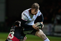 Ulster Rugby's Andrew Trimble is tackled by Dragons' Adam Warren<br /> <br /> Photographer Simon King/Replay Images<br /> <br /> Guinness Pro14 Round 10 - Dragons v Ulster - Friday 1st December 2017 - Rodney Parade - Newport<br /> <br /> World Copyright © 2017 Replay Images. All rights reserved. info@replayimages.co.uk - www.replayimages.co.uk