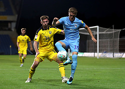 Coventry City's Jordan Ponticelli (right) and Oxford United's James Henry (left) battle for the ball