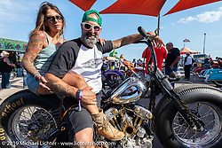 T4 Motorcycles' Stéphane Grand of Geneva, Switzerland with his wife Emanuela and his SG4 custom Harley-Davidson Knucklehead at the Rats Hole annual custom bike show in the Crossroads area of the Buffalo Chip during the Sturgis Black Hills Motorcycle Rally. SD, USA. Thursday, August 8, 2019. Photography ©2019 Michael Lichter.