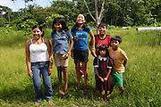 Ecuador, May 6 2010: Huaorani children jump for the camera. Copyright 2010 Peter Horrell