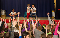 """Ryan Vezina with Blake and Justin Spencer of Recycled Percussion announce the start of the """"Kindness Club"""" at Pleasant Street School during their surprise visit on Friday afternoon.   (Karen Bobotas/for the Laconia Daily Sun)"""