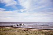 Empty beach and groins for wave control at the shoreline in Snettisham in North Norfolk, UK
