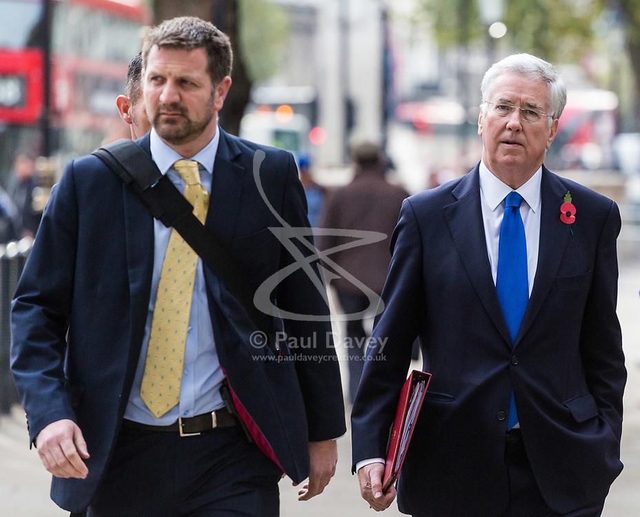 London, November 01 2017. Defence Secretary Sir Michael Fallon (right) is seen walking on Whitehall. © Paul Davey