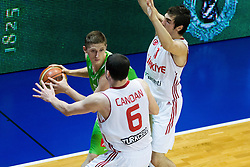 Gezim Morina of Slovenia vs Berkay Candan of Turkey and Ahmet Cantitiz of Turkey during basketball match between National teams of Turkey and Slovenia in Qualifying Round of U20 Men European Championship Slovenia 2012, on July 17, 2012 in Domzale, Slovenia. Slovenia defeated Turkey 72-71 in last second of the game. (Photo by Vid Ponikvar / Sportida.com)