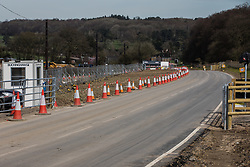 Chalfont St Giles, UK. 30 March, 2021. A temporary haul road constructed in connection with works for a ventilation shaft for the Chiltern Tunnel section of the HS2 high-speed rail link. The works, off Bottom House Farm Lane, include the construction of the ventilation shaft and an embankment as well as the temporary haul road.