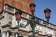 Traditional street lamps with filtered pink glass, in st mark's square Venice, Italy. Modern energy saving light bulbs are used throughout the lighting in the square.
