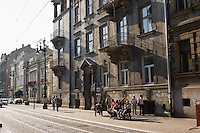people queue for tram in sunny afternoon street scene on the edges of krakow old town