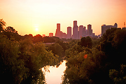 Houston, Texas skyline at sunrise from Buffalo Bayou.