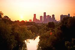 Houston, Texas skyline at sunrise from Buffalo Bayou.