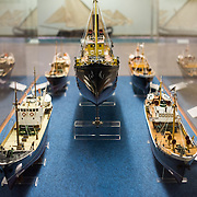 At center is a 1:28 model of the Cabo Branco, an off-shore fishing steamer vessel built in 1916. The Museu de Marinha (Maritime Museum of Navy Museum) focuses on Portuguese maritime history. It features exhibits on Portugal's Age of Discovery, the Portuguese Navy, commercial and recreational shipping, and, in a large annex, barges and seaplanes. Located in the Belem neighborhood of Lisbon, it occupies, in part, one wing of the Jerónimos Monastery. Its entrance is through a chapel that Henry the Navigator had built as the place where departing voyagers took mass before setting sail. The museum has occupied its present space since 1963.