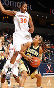 Nov. 14, 2010; Charlottesville, VA, USA;  Mount St. Mary's guard Syd Henderson (22) is fouled by Virginia forward Telia McCall (30) during the game at the John Paul Jones Arena. Virginia won 81-58. Virginia won 81-58. Mandatory Credit: Andrew Shurtleff-