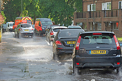 © Licensed to London News Pictures 20/07/2021. Orpington, UK. Heatwave thunderstorms hit Orpington in South East London causing roads to flood and drains to overflow. Photo credit:LNP