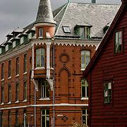Three weeks aboard the Kong Harald. Hurtigruten, the Coastal Express. Bergen. Large red building.