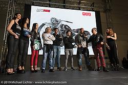 MS Artrix' Massimo Gullone gets an award at LowRide Magazine Italy's bike show award ceremony at Motor Bike Expo. Verona, Italy. Sunday January 21, 2018. Photography ©2018 Michael Lichter.